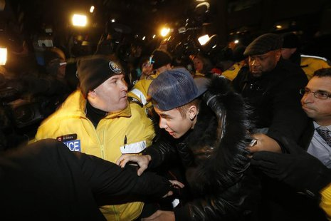 Pop singer Justin Bieber arrives at a police station in Toronto January 29, 2014. REUTERS/Alex Urosevic