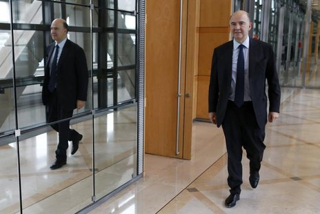 France's Finance Minister Pierre Moscovici leaves after an interview with Reuters at Bercy Finance Ministry in Paris, January 30, 2014. REUT