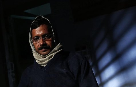 Delhi's Chief Minister Arvind Kejriwal, chief of the Aam Aadmi (Common Man) Party (AAP), poses before the start of an interview with Reuters