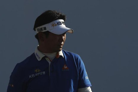 Yang Yong-eun of South Korea walks on the 18th hole during the third round of the Hong Kong Open golf tournament at the Hong Kong golf club