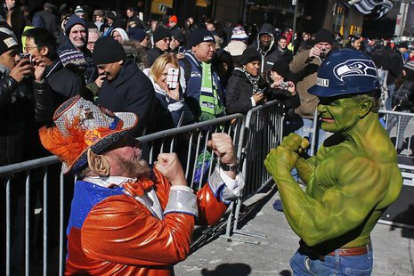 A fan of Seattle Seahawks (R) jokes with a fan of Denver Broncos at the Super Bowl Boulevard fan zone ahead of Super Bowl XLVIII in New York