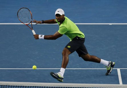 Donald Young of the United States plays a return to Kei Nishikori of Japan during their men's singles match at the Australian Open 2014 tenn