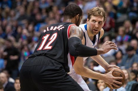 Jan 18, 2014; Dallas, TX, USA; Portland Trail Blazers power forward LaMarcus Aldridge (12) guards Dallas Mavericks power forward Dirk Nowitz