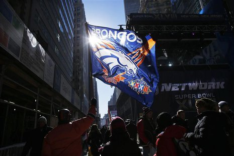 Fans walk along Super Bowl Boulevard fan zone ahead of Super Bowl XLVIII in New York January 30, 2014. REUTERS/Eduardo Munoz