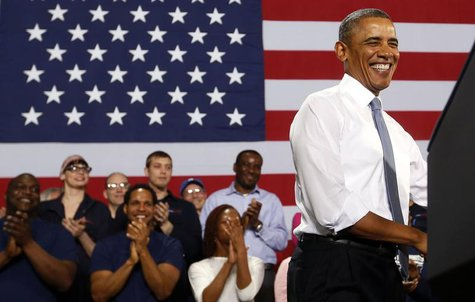 U.S. President Barack Obama smiles before he addresses employees of General Electric's Waukesha Gas Engines facility in Waukesha, Wisconsin,