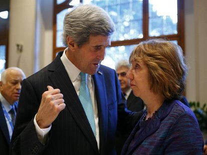 U.S. Secretary of State John Kerry (L) talks to EU foreign policy chief Catherine Ashton prior to peace talks in Montreux January 22, 2014.