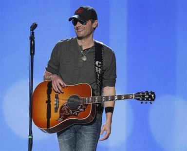 "Singer Eric Church smiles after performing ""Springsteen"" at the 47th annual Academy of Country Music Awards in Las Vegas, Nevada, April 1, 2"