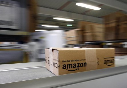 A parcel moves on the conveyor belt at Amazon's logistics centre in Graben near Augsburg December 16, 2013. REUTERS/Michaela Rehle