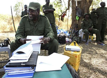 South Sudan's rebel leader Riek Machar sits in the bush in a rebel-controlled territory in Jonglei State January 31, 2014. REUTERS/Goran Tom