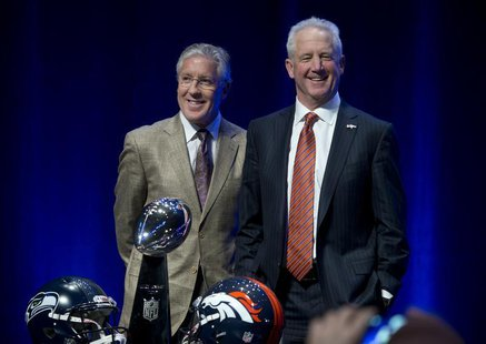 Head coach Pete Carroll (L) of the Seattle Seahawks and head coach John Fox of the Denver Broncos pose for a photo before their news confere