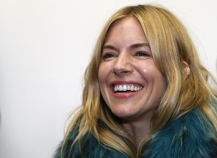 Actress Sienna Miller arrives for the Matthew Williamson Spring/Summer 2014 collection presentation during London Fashion Week September 15,