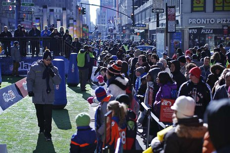Fans gather in the Super Bowl Boulevard fan zone ahead of Super Bowl XLVIII in New York January 30, 2014. REUTERS/Eduardo Munoz