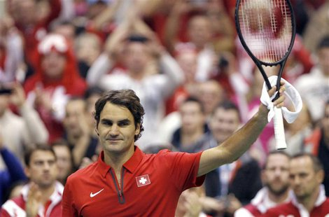 Switzerland's Roger Federer celebrates after his Davis Cup World group first round tennis match against Serbia's Ilija Bozoljac in Novi Sad