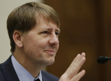 Consumer Financial Protection Bureau Director Richard Cordray testifies before the House Financial Services Committee in Washington Septembe