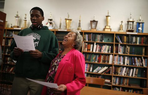 Velma Smith sings with one of the students in the library at Leo Catholic High School in Chicago, Illinois February 14, 2013. REUTERS/Jim Yo