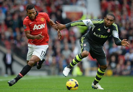Manchester United's Nani (L) challenged by Stoke City's Wilson Palacios during their English Premier League soccer match at Old Trafford Sta