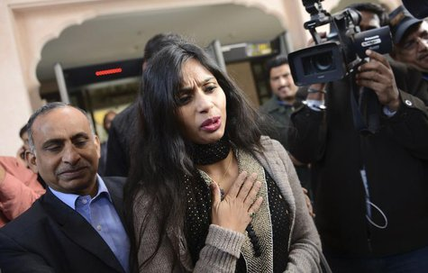 Indian diplomat Devyani Khobragade (C) leaves with her father Uttam Khobragade (L) from the Maharashtra Sadan state guesthouse to meet India