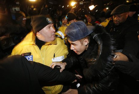 Pop singer Justin Bieber arrives at a police station to face assault charges in Toronto in this file photo taken January 29, 2014. REUTERS/A