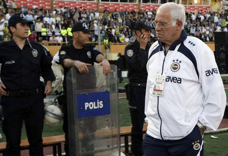 Former Fenerbahce's Spanish coach Luis Aragones waits for the start of their Turkish Cup final soccer match against Besiktas at the Ataturk