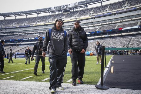 Seattle Seahawks running back Marshawn Lynch (C) walks off the field at the MetLife Stadium during their NFL Super Bowl XLVIII walk-through