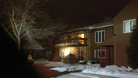 Flames visible in upper condo unit at 3233 16th Avenue South Fargo