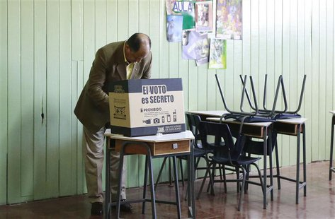 Luis Guillermo Solis, presidential candidate for Citizens' Action Party, casts his vote at a polling station during the presidential electio