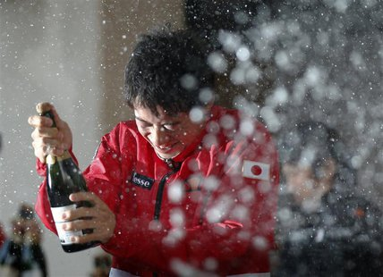 Champagne is sprayed on Japan's Kei Nishikori by his teammates as they celebrate their victory over Canada at their Davis Cup world group fi