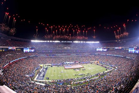 East Rutherford, NJ, USA; Fireworks go off during the playing of the national anthem before Super Bowl XLVIII between the Seattle Seahawks a