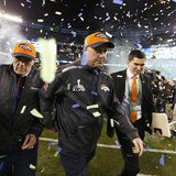 Denver Broncos head coach John Fox leaves the field after the Broncos werer defeated by the Seattle Seahawks in the NFL Super Bowl XLVIII fo