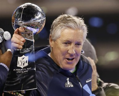 Seattle Seahawks head coach Pete Carroll holds the Vince Lombardi trophy after the Seahawks defeated the Denver Broncos in the NFL Super Bow
