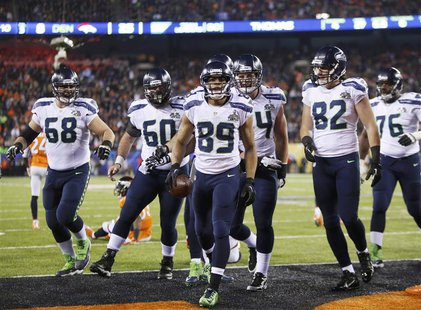 Seattle Seahawks wide receiver Doug Baldwin (89) celebrates his touchdown against the Denver Broncos with teammates during the fourth quarte