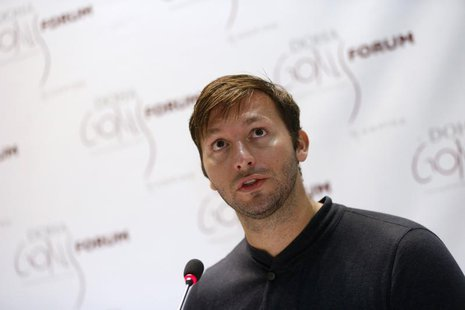 Five-time Olympic gold medalist Australia's Ian Thorpe speaks during the news conference for the Doha Gathering of All Leaders In Sport (GOA
