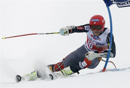 Bode Miller of the U.S. clears a gate during the first run of the men's World Cup giant slalom race in St. Moritz February 2, 2014. REUTERS/