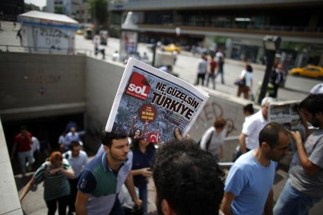 A man sells newspapers to people as they leave the subway station at Taksim Square in Istanbul June 4, 2013. REUTERS/Stoyan Nenov