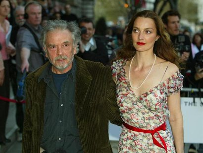 British photographer David Bailey (L) and his wife Catherine Bailey arrive for the opening of the new Saatchi Gallery in London, April 15, 2