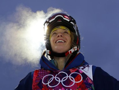 U.S. mogul skier Hannah Kearney looks up at the mountain while taking a break during a night training session for the 2014 Sochi Winter Olym