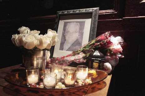 Flowers and candles are laid at a memorial for actor Philip Seymour Hoffman outside Philip Marie Restaurant and bar on Hudson Street in Manh