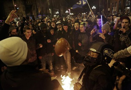 Seattle Seahawks fans celebrate by starting a small fire in the street after their team won the NFL Super Bowl XLVIII in Seattle, Washington