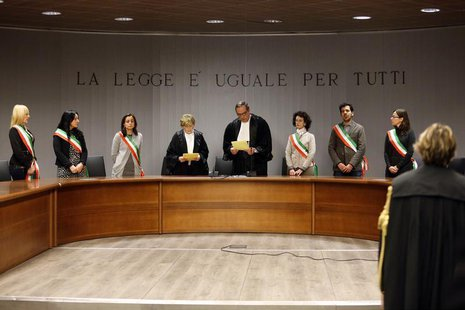 Judge Alessandro Nencini (C) reads the verdict during the retrial session of Amanda Knox and Raffaele Sollecito in Florence January 30, 2014