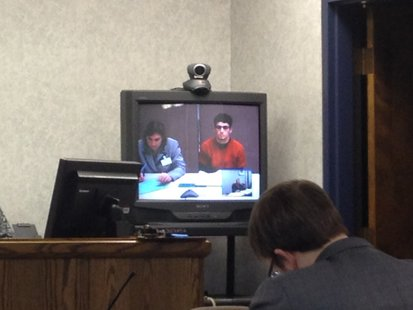 Dorian Torres (right on TV screen) appears for a preliminary hearing in the Sheboygan County Courthouse.