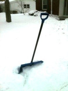 Snow shovel in snow bank