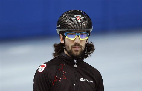 Short track speed skater Charles Hamelin of Canada practises in preparation for the 2014 Sochi Winter Olympics, February 2, 2014. REUTERS/Lu