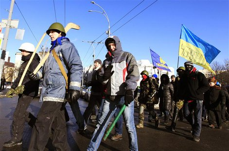 Anti-government protesters march on the streets in Kiev February 4, 2014. REUTERS/Vasily Fedosenko