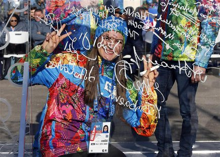 Russian pole vaulter and Mayor of the Coastal Cluster Olympic Village Yelena Isinbayeva gestures after signing the Olympic truce wall in Soc