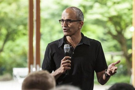 Satya Nadella, executive vice president, Cloud and Enterprise, addresses employees during the One Microsoft Town Hall event in Seattle, Wash