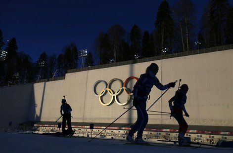 "Olympic skiers take part in a biathlon training session for the 2014 Sochi Winter Olympic Games at the ""Laura"" cross-country and biathlon ce"