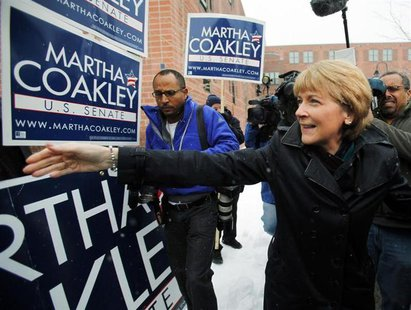 Democratic candidate for the U.S. Senate Martha Coakley (R) greets supporters outside the polling station where she cast her ballot in the s