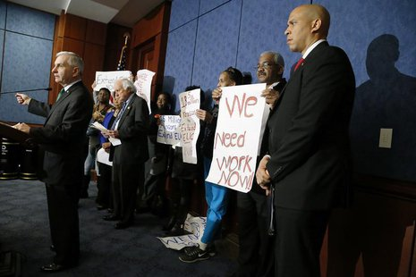 Senator Jack Reed (L) (D-RI) and U.S. Senator Cory Booker (D-NJ) hold a news conference with unemployed Americans to highlight their politic