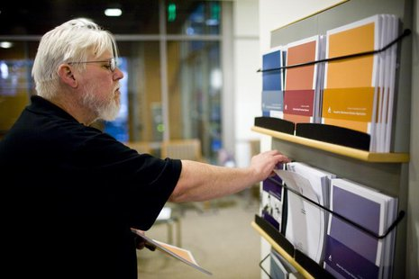 California state worker Curtis Walker looks over retirement plan brochures at the Calpers regional office in Sacramento, California October