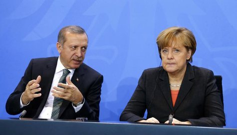 German Chancellor Angela Merkel and Turkey's Prime Minister Tayyip Erdogan address the media after talks in Berlin February 4, 2014. REUTERS
